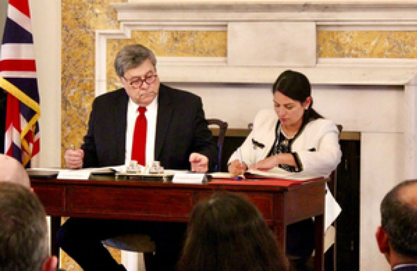 Priti Patel Signing Agreement With William Barr
